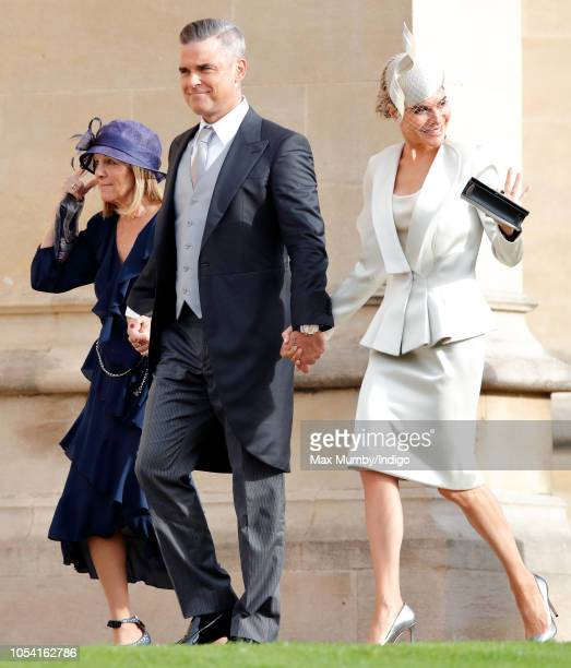 Gwen Field Robbie Williams and Ayda Field attend the wedding of Princess Eugenie of York and Jack Brooksbank at St George's Chapel on October 12 2018...