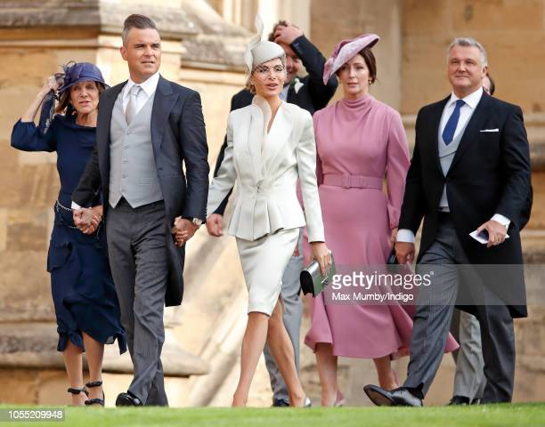 Gwen Field Robbie Williams Ayda Field Zoe de Givenchy and Olivier de Givenchy attend the wedding of Princess Eugenie of York and Jack Brooksbank at...