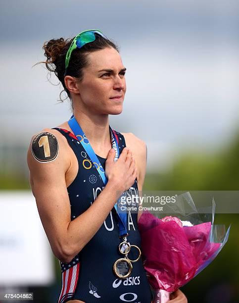 Gwen Jorgensen of America celebrates after winning the womens race during the Vitality World Triathlon London ITU World Championships Series at Hyde...