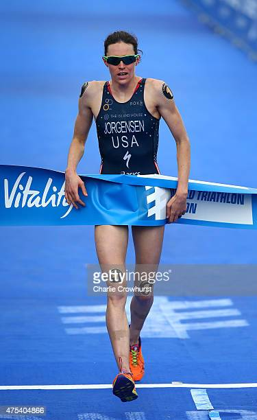 Gwen Jorgensen of America crosses the line exhausted after winning the womens race during the Vitality World Triathlon London ITU World Championships...