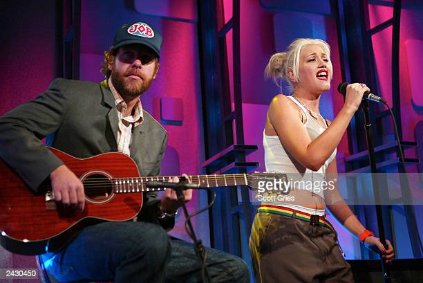 Gwen Stefani and Tom Dumont of No Doubt perform during the TRL 1000th episode celebration at the MTV Studios in Times Square, New York City. 10/23/02...