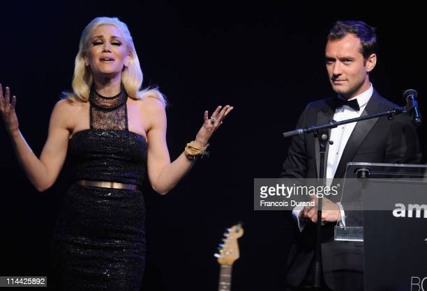 Gwen Stefani appears onstage with Jude Law at amfAR's Cinema Against AIDS Gala during the 64th Annual Cannes Film Festival at Hotel Du Cap on May 19,...