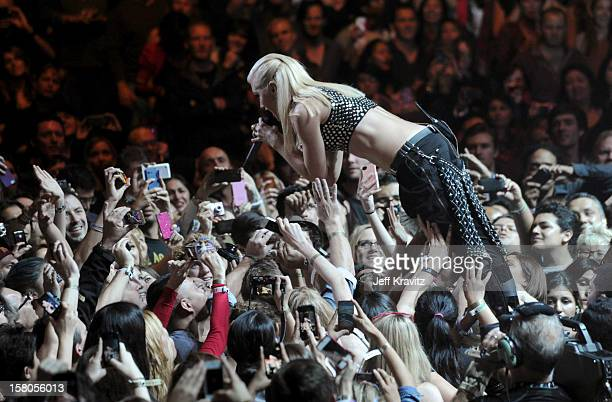 Gwen Stefani of No Doubt crowdsurfs while performing at the KROQ Acoustic Xmas show at Gibson Amphitheatre on December 9 2012 in Universal City...