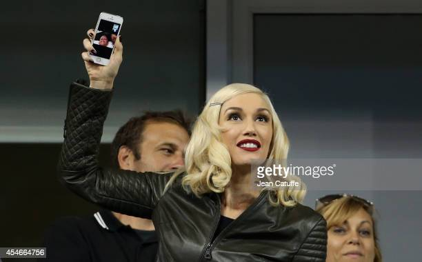 Gwen Stefani shares a few minutes of the match between Roger Federer of Switzerland and Gael Monfils of Francewith with her sons Kingston Rossdale...