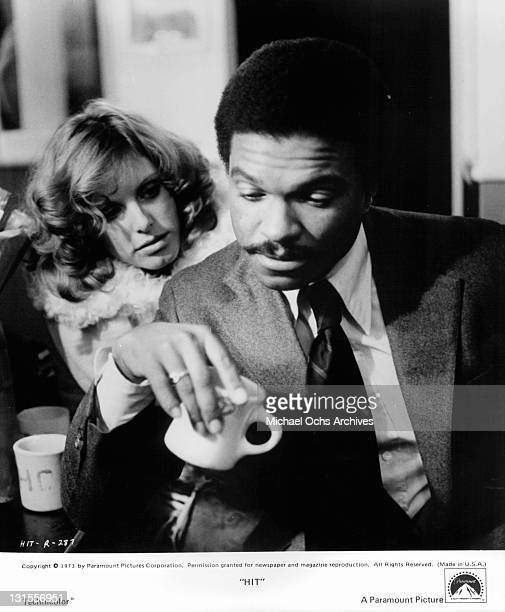 Gwen Welles and Billy Dee Williams discuss the danger of their topsecret mission in a scene from the film 'Hit' 1973
