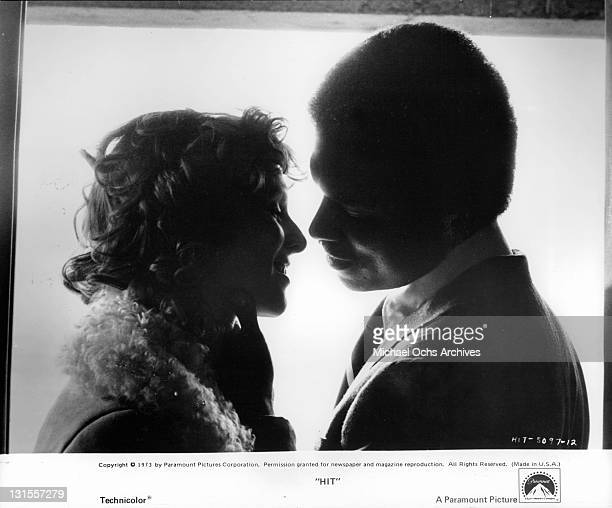 Gwen Welles and Billy Dee Williams share a passionate moment before their deadly mission in a scene from the film 'Hit' 1973