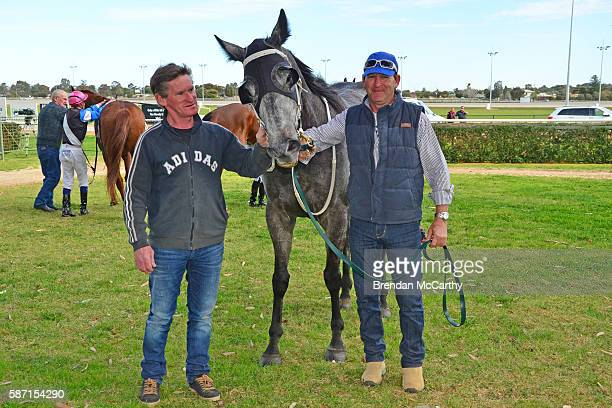 Gwenda Johnstone She's Just Lika and strapper Dean Boal after winning Vetta Spaghetti BM58 Handicap at Swan Hill Racecourse on August 08 2016 in Swan...