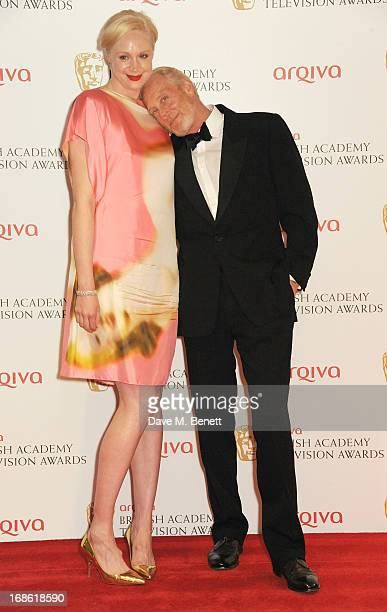 Gwendoline Christie and Charles Dance pose in the press room at the Arqiva British Academy Television Awards 2013 at the Royal Festival Hall on May...