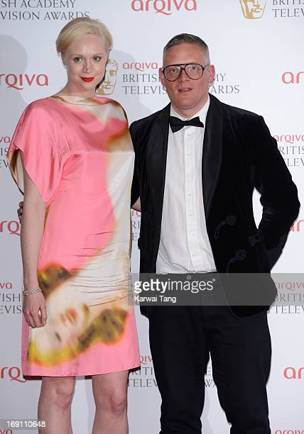 Gwendoline Christie and Gilles Deacon pose in the press room at the Arqiva British Academy Television Awards 2013 at the Royal Festival Hall on May...