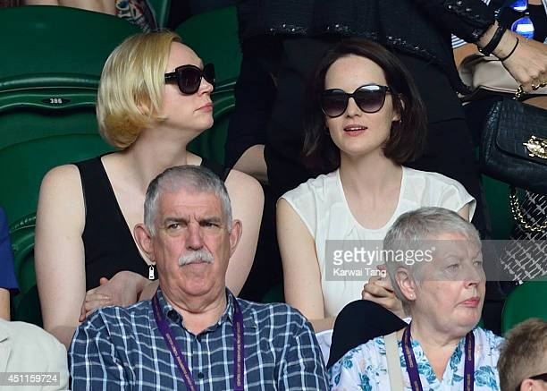 Gwendoline Christie and Michelle Dockery attend the Martin Klizan v Rafael Nadal match on centre court during day two of the Wimbledon Championships...