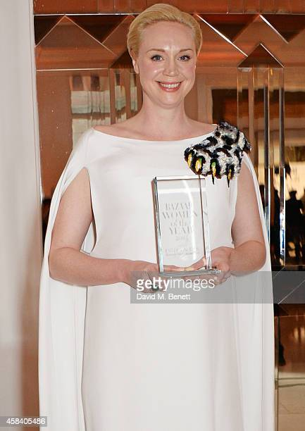 Gwendoline Christie winner of the British Actress of the Year award poses at the Harper's Bazaar Women Of The Year awards 2014 at Claridge's Hotel on...