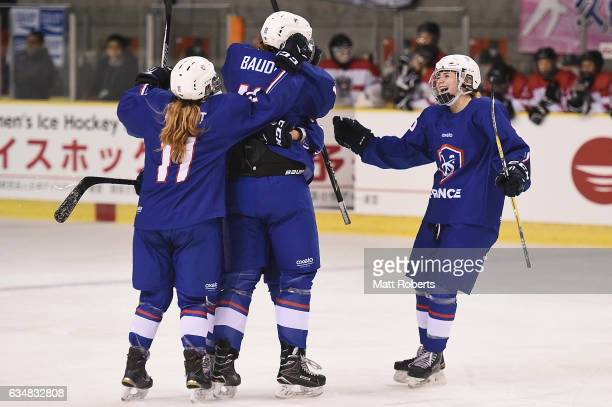 Gwendoline Gendarme of France celebrates scoring a goal with team mates during the Women's Ice Hockey Olympic Qualification Final game between France...