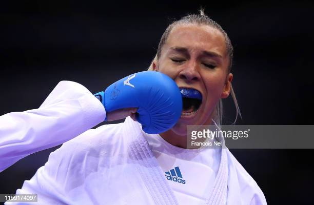 Gwendoline Phillippe of France is punched by Jovana Prekovic of Serbia in the Women's 61kg Karate Group B match during day ten of the 2nd European...