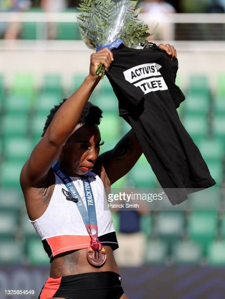 Gwendolyn Berry displays an Activist Athlete shirt as she celebrates finishing third in the Women's Hammer Throw final on day nine of the 2020 U.S....