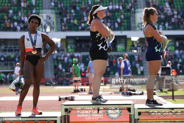 Gwendolyn Berry , third place, turns away from U.S. Flag during the U.S. National Anthem as DeAnna Price , first place, and Brooke Andersen, second...