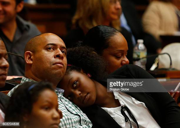 Gwendolyn Castro of Dorchester whose grandmother Gricelda E Garo James was killed on 9/11 lays her head on her uncle Jacobo Castro's chest as a...