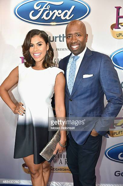 Gwendolyn Smith and Kenny Smith attend the 2015 Ford Neighborhood Awards Hosted By Steve Harvey at Phillips Arena on August 8 2015 in Atlanta Georgia
