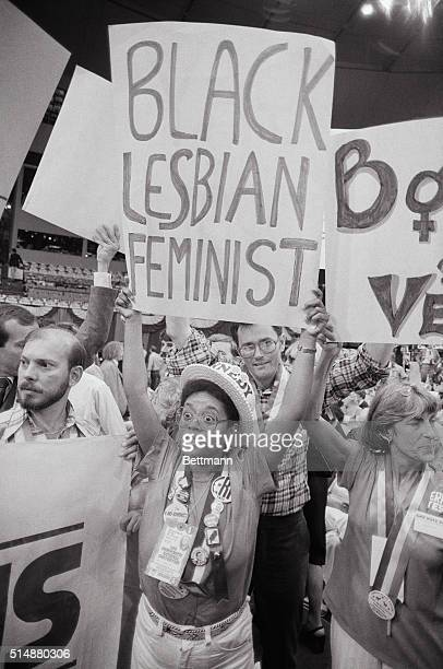 Gwenn Craig, of San Francisco, CA, holds aloft a poster reading 'Black Lesbian Feminist' during final session of Democratic Convention, New York, US,...