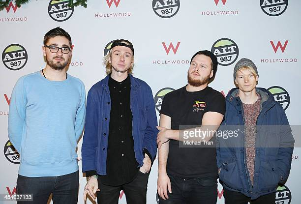 Gwil Sainsbury Joe Newman Gus UngerHamilton and Thom Green of AltJ attend The ALTimate Rooftop Christmas party held at W Hollywood on December 9 2013...