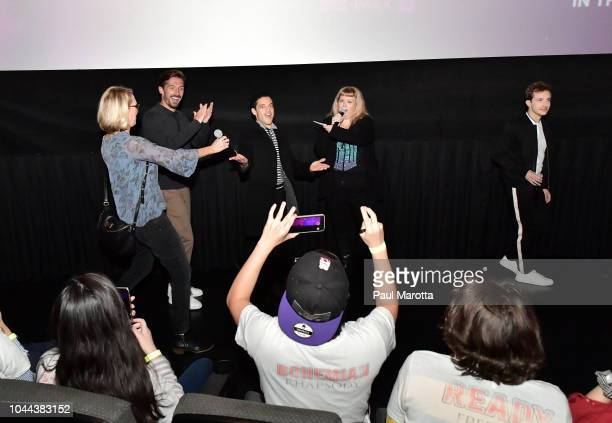 Gwilym Lee Angie C from WZLX Rami Malek and Joseph Mazzello attend the Boston red carpet screening of 'Bohemian Rhapsody' the film about the rock...