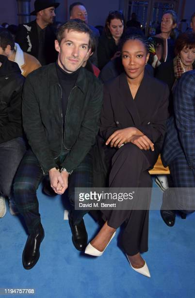 Gwilym Lee wearing Paul Smith and Naomi Ackie wearing Paul Smith attend the Paul Smith AW20 50th Anniversary show as part of Paris Fashion Week on...