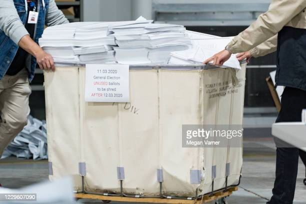 Gwinnett county workers begin their recount of the ballots on November 13, 2020 in Lawrenceville, Georgia. The difference in votes between US...