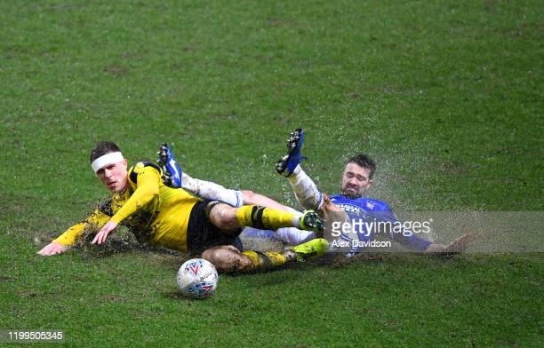 Gwion Edwards of Ipswich Town is challenged by Josh Ruffels of Oxford United during the Sky Bet Leauge One match between Oxford United and Ipswich...