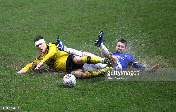 Gwion Edwards of Ipswich Town is challenged by Josh Ruffels of Oxford United during the Sky Bet League One match between Oxford United and Ipswich...