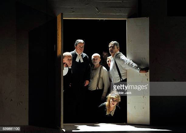 Gwion Thomas Nicholas Folwell Michael Bennett Paul Curievici Amanda Forbes Rowan Hellier and Michael Druiett in Philip Glass's The Trial directed by...