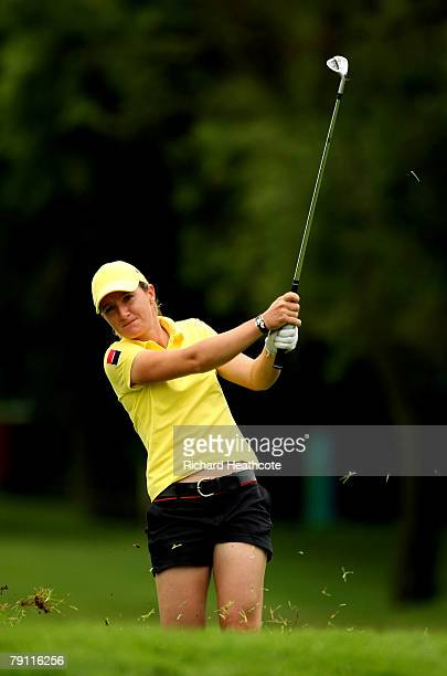 Gwladys Nocera of France pitches into the 9th green during the second round of the Women's World Cup of Golf at The Gary Player Country Club on...