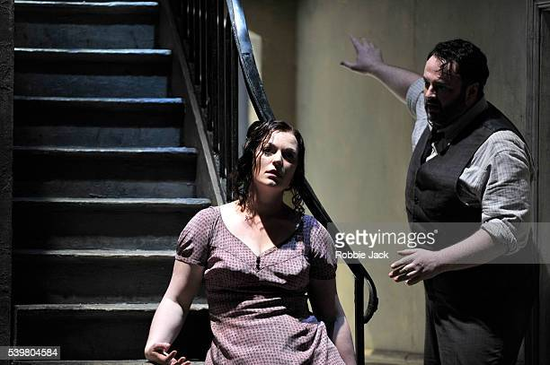 Gwyn Hughes Jones as Rodolfo and Kate Valentine as Mimi in the English National Opera's production of Giacomo Puccini's La boheme directed by...