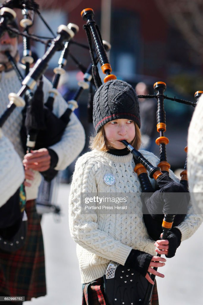 Gwyneth Fitzsimmons, 11, of Windham plays the bagpipes while marcing with the Claddagh Mhor Pipe Band in the Irish American Club's annual St. Patrick's Parade on Commercial Street.