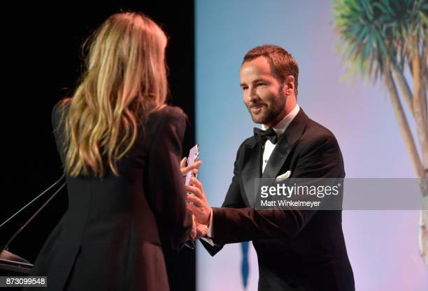 Gwyneth Paltrow accepts the Giving Tree Award from Tom Ford at The 2017 Baby2Baby Gala presented by Paul Mitchell on November 11 2017 in Los Angeles...