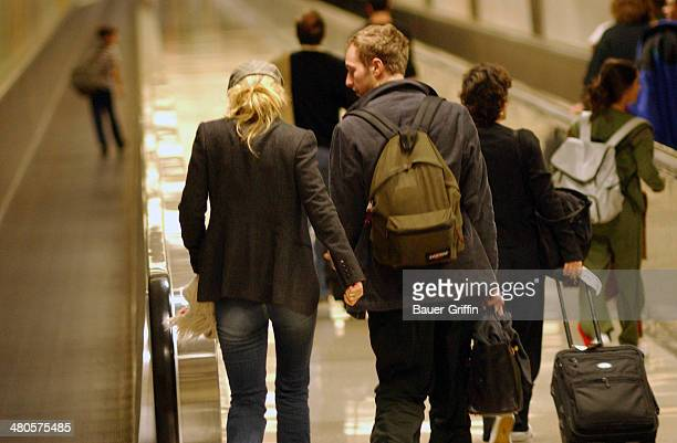 Gwyneth Paltrow and Chris Martin are seen at LAX on December 30 2002 in Los Angeles California