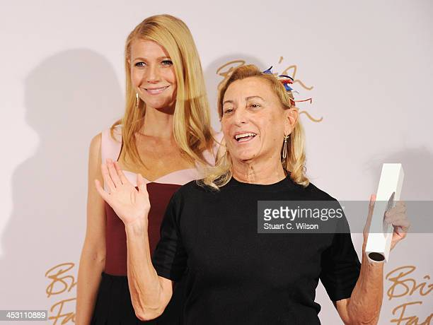 Gwyneth Paltrow and Miuccia Prada with the award for International Designer of the Year pose in the winners room at the British Fashion Awards 2013...
