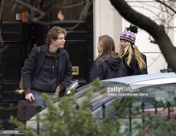 Gwyneth Paltrow & Chris Martin, With Her Brother & Mother, Leave Their London Home On Their Way To His Parents Home In Devon For Christmas.Exclusive .