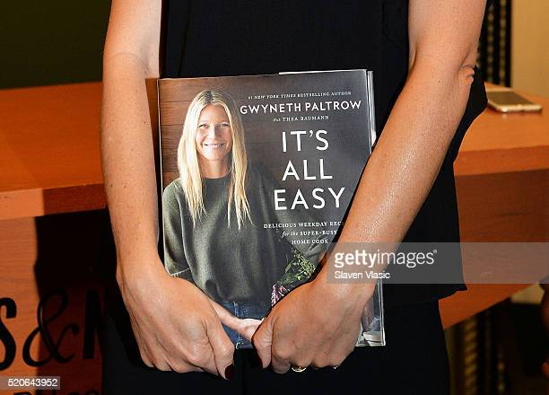 Gwyneth Paltrow hands and book detail signs copies of her new book It's All Easy at Barnes Noble 5th Avenue on April 12 2016 in New York City