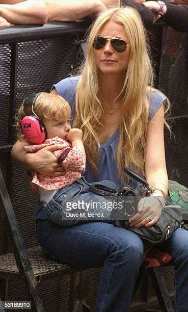 "Gwyneth Paltrow holds her daughter Apple as she watches ""Live 8 London"" in Hyde Park on July 2, 2005 in London, England. The free concert is one of..."