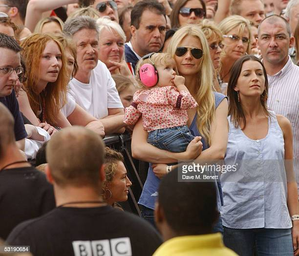 "Gwyneth Paltrow holds her daughter Apple as she watches the performances during ""Live 8 London"" in Hyde Park on July 2, 2005 in London, England. The..."