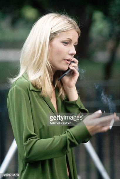 Gwyneth Paltrow smokes a cigarette and talks on her cellular phone during a work break She works on filming the motion picture Great Expectations