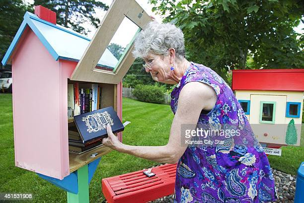 Gwynetth Jones checks the books in her Little Free Libary she built in her front yard in Mission Kan to share books with neighbors The small sharing...