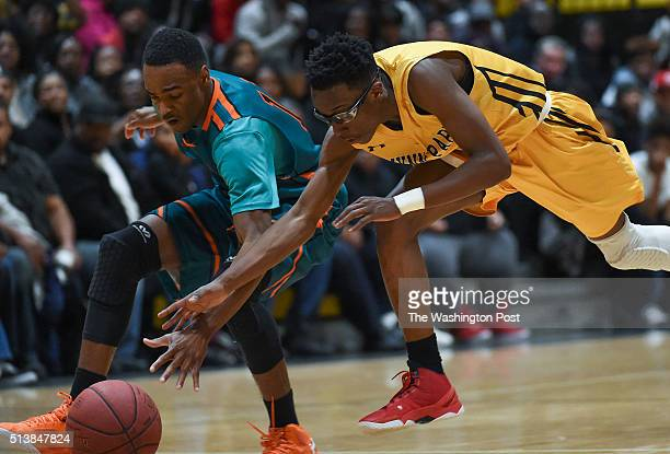 Gwynn Park's Justin Faison right reaches for the ball as Westlake's Everett Mouton almost knocks it away during the Maryland 2A South Region boys'...