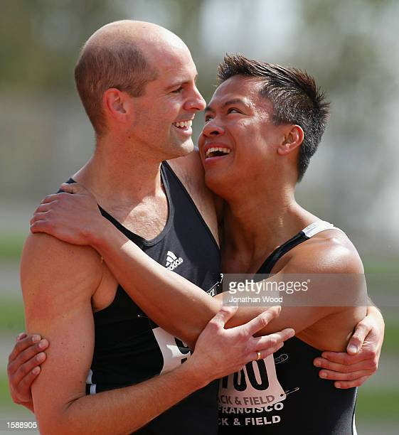 Gwynn Villegas of San Fransisco USA is congratulted by a team mate after winning siver in the Men's 30 years 400 metre hurdles during the 2002 Sydney...