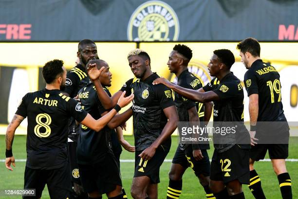 Gyasi Zardes of Columbus Crew celebrates with his teammates after scoring a goal during the second half of their game against Atlanta United at...