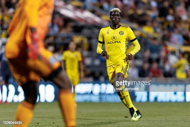 Gyasi Zardes of Columbus Crew SC watches as Sean Johnson of New York City FC stops the ball in the MLS regular season game between the Columbus Crew...
