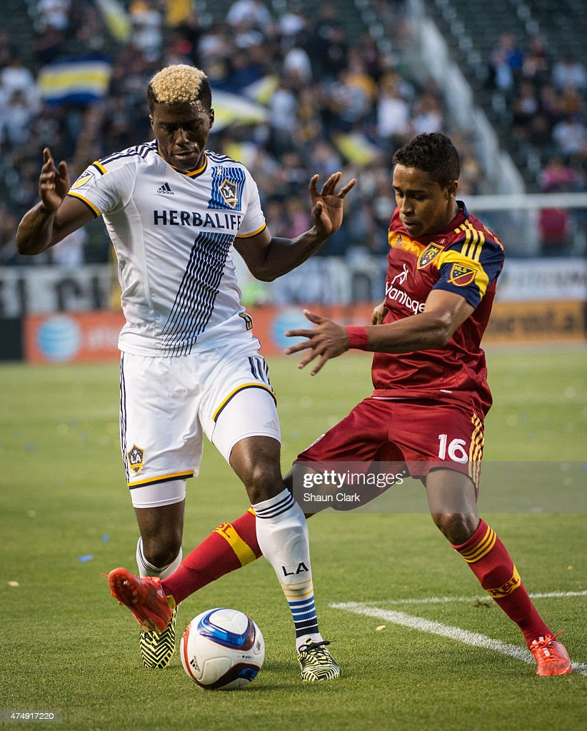 Gyasi Zardes (11) of Los Angeles Galaxy battles Pecka (16) of Real Salt Lake during Los Angeles Galaxy's match against Real Salt Lake at the Stubhub Center on May 27, 2015 in Carson, California. The LA Galaxy won the match 1-0.