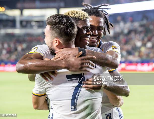 Gyasi Zardes of Los Angeles Galaxy celebrates his goal with Romain Alessandrini and Bradford Jamieson IV of Los Angeles Galaxy during the Los Angeles...
