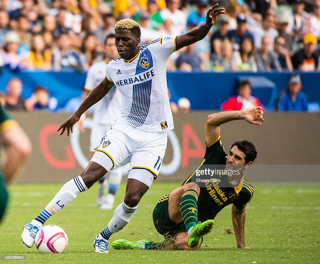 Gyasi Zardes #11 of Los Angeles Galaxy goes past Diego Valeri #8 of Portland Timbers during Los Angeles Galaxy's MLS match against Portland Timbers at the StubHub Center on October 18, 2015 in Carson, California. The Portland Timbers won the match 5-2