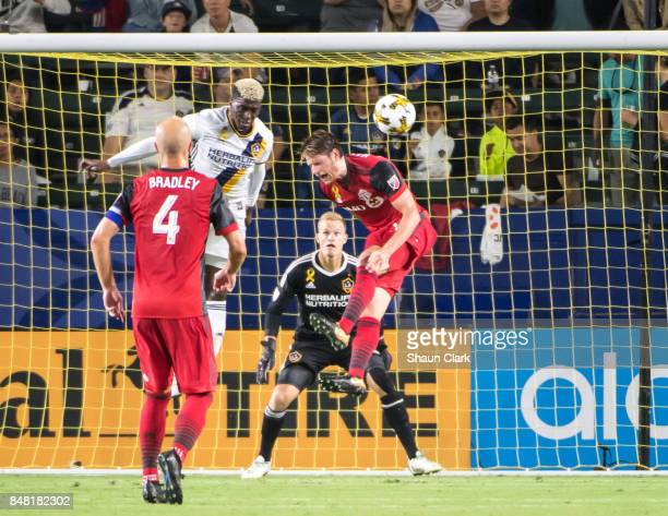 Gyasi Zardes of Los Angeles Galaxy heads the ball clear during the Los Angeles Galaxy's MLS match against Toronto FC at the StubHub Center on...