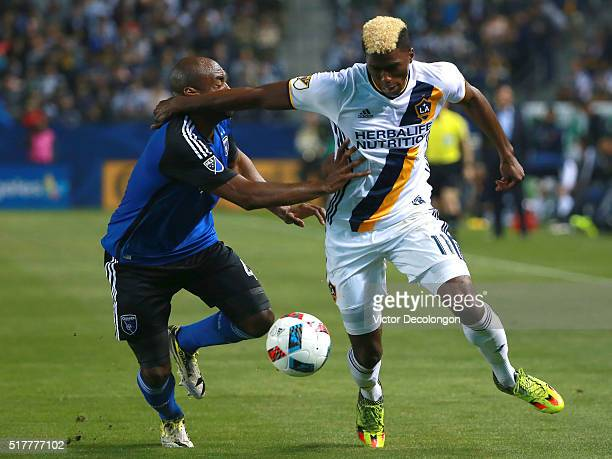 Gyasi Zardes of the Los Angeles Galaxy and Marvell Wynne of the San Jose Earthquakes vie for position to the ball during the second half of their MLS...